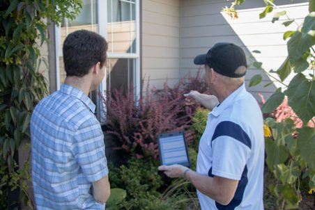 Home inspector with client assessing a residence.